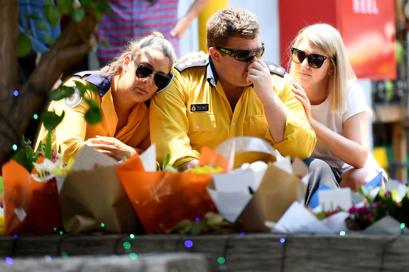 Members of the Horsley Park RFS are seen at a memorial for volunteer firefighters O'Dwyer and Keaton in Horsley Park