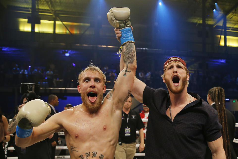 Jake Paul celebrates with his brother, Logan, after defeating AnEsonGib in a first round knockout during their fight at Meridian at Island Gardens on January 30, 2020 in Miami, Florida. (Photo by Michael Reaves/Getty Images)