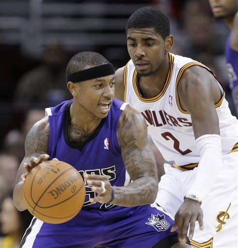 Sacramento Kings' Isaiah Thomas, front, tries to get past Cleveland Cavaliers' Kyrie Irving in the fourth quarter of an NBA basketball game Sunday, Feb. 19, 2012, in Cleveland. Thomas scored a team-high 23 points. The Cavaliers won 93-92. (AP Photo/Tony Dejak)