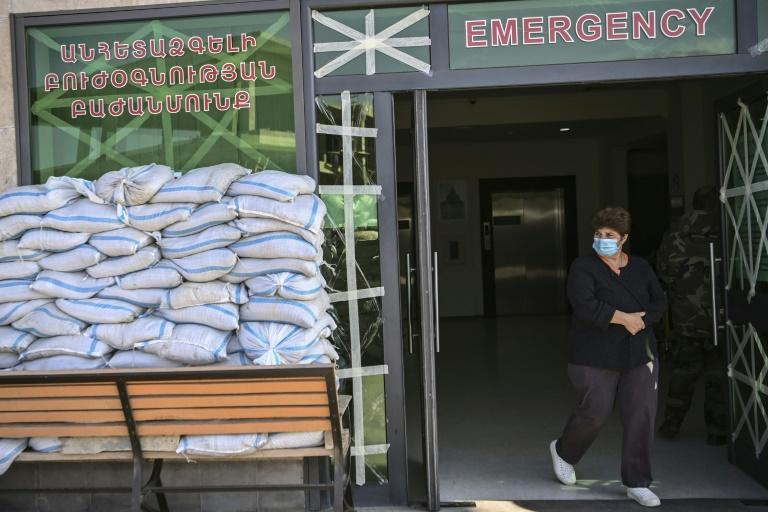 The entrance to the hospital is piled high with sandbags