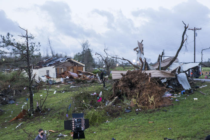 Damaged properties near the intersection of County Road 24 and 37 in Clanton, Ala., are shown early Thursday, March 18, 2021, the morning after a large outbreak of severe storms pounded the southeast. (AP Photo/Vasha Hunt)