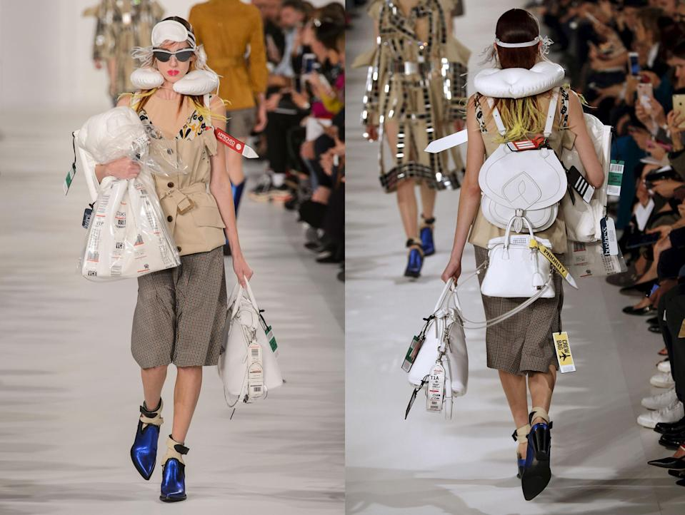 Models wear travel tags as accessories from the SS18 Maison Margiela collection. (Photo: ImaxTree, Getty)