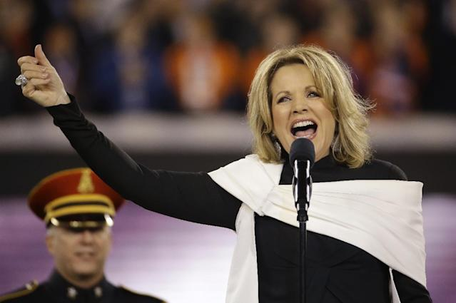 Opera singer Renée Fleming sings the national anthem before the NFL Super Bowl XLVIII football game between the Seattle Seahawks and the Denver Broncos Sunday, Feb. 2, 2014, in East Rutherford, N.J. (AP Photo/Matt Slocum)