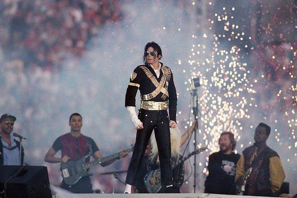"""<p>Michael Jackson wore a military-style jacket with aviator sunglasses for his performance.</p><p><a class=""""link rapid-noclick-resp"""" href=""""https://www.youtube.com/watch?v=EsopN7JKUVs&ab_channel=UniversMichaelJackson"""" rel=""""nofollow noopener"""" target=""""_blank"""" data-ylk=""""slk:WATCH NOW"""">WATCH NOW</a></p>"""