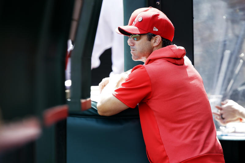 Los Angeles Angels manager Brad Ausmus looks out at the field during the first inning of a baseball game against the Houston Astros in Anaheim, Calif., Sunday, Sept. 29, 2019. (AP Photo/Alex Gallardo)