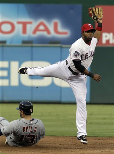 Texas Rangers shortstop Elvis Andrus, right, leaps over sliding Detroit Tigers' Alex Avila (13) during a double play in the fourth inning of a baseball game on Friday, Aug. 10, 2012, in Arlington, Texas. Tigers' Jhonny Peralta was out at first base. (AP Photo/LM Otero)