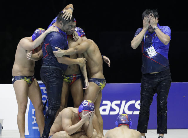 Philippines water polo team react after their game against Singapore at the 30th South East Asian Games in New Clark City, Tarlac province, northern Philippines on Friday, Nov. 29, 2019. Philippines scored a draw against Singapore 6-6. (AP Photo/Aaron Favila)