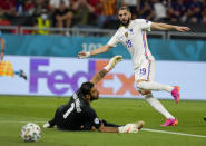 France's Karim Benzema, right, kicks the ball past Portugal's goalkeeper Rui Patricio to score his team's second goal during the Euro 2020 soccer championship group F match between Portugal and France at the Puskas Arena, Budapest, Hungary, Wednesday, June 23, 2021. (AP Photo/Darko Bandic,Pool)