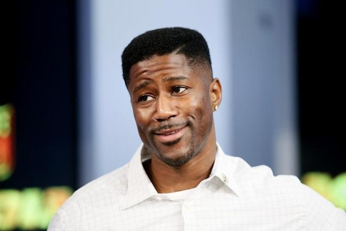 """FILE - In this Sept. 9, 2015, file photo, former NFL player Nate Burleson is interviewed during a media availability on set at the at NFL Network studios in Culver City, California. CBS is making another change to its cast for the """"NFL Today"""" show on Sundays, adding Nate Burleson to replace Bart Scott. Burleson is the second newcomer to the program, although Phil Simms is moving from the broadcast booth to the studio. That switch was announced last month. (AP Photo/Danny Moloshok, File)"""