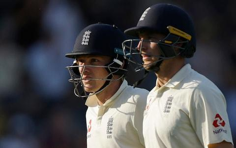 England's Dom Bess, left and England's Jos Butler walk from the pitch at the end of play on the third day of play of the first test cricket match between England and Pakistan at Lord's cricket ground in London, Saturday - Credit: AP