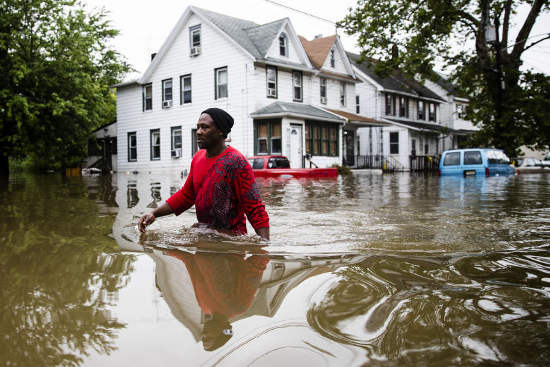 Chris Smith makes his way through floodwaters to the Macedonia Baptist Church in Westville, N.J., Thursday, June 20, 2019. Severe storms containing heavy rains and strong winds spurred flooding across southern New Jersey, disrupting travel and damaging some property. (Photo: Matt Rourke/AP)