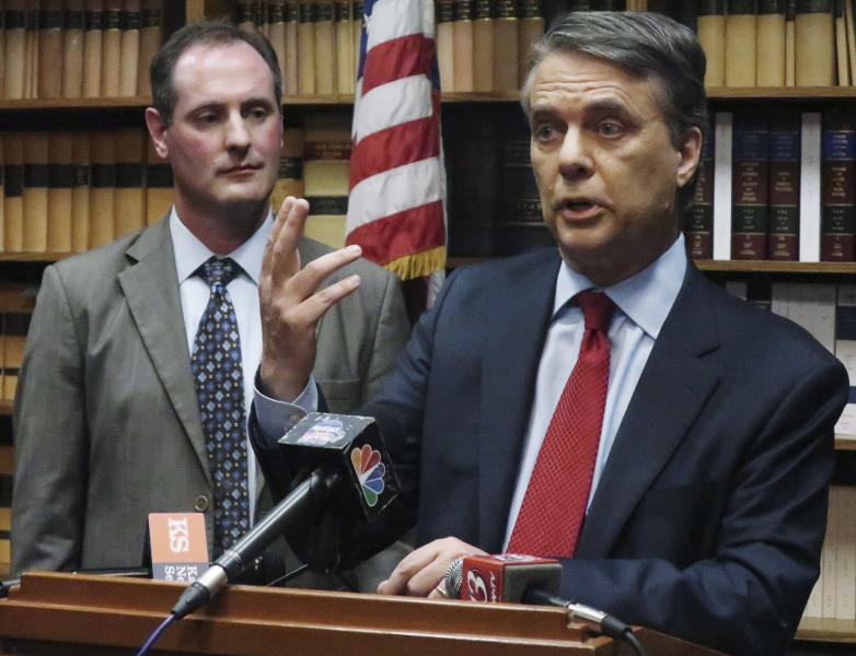 "FILE - In this May 30, 2018, file photo, Kansas Gov. Jeff Colyer, right, answers a question from reporters as Lt. Gov. Tracey Mann, left, listens during a news conference in Topeka, Kan. Kansas Gov. Colyer in February issued an executive order that requires his staff to use official email accounts for all government business. He also banned private accounts for any communications related to ""the functions, activities, programs, or operations"" of the office. (AP Photo/John Hanna, File)"