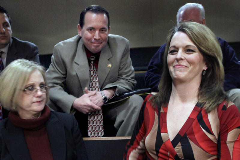 Julie Mayberry, right, wife of Rep. Andy Mayberry, R-Hensley, center, and Rose Mimms, executive director of Arkansas Right to Life, left, sit in a gallery at the Senate chamber at the Arkansas state Capitol in Little Rock, Ark., after the Senate voted to override the governor's veto of Mayberry's bill banning most abortions in the 20th week Thursday, Feb. 28, 2013. (AP Photo/Danny Johnston)