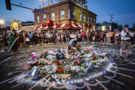 FILE - Protesters gather at a memorial for George Floyd, June 1, 2020, in front of Cup Foods in Minneapolis. Floyd was killed May 25 while in police custody outside the store. (AP Photo/John Minchillo, File)