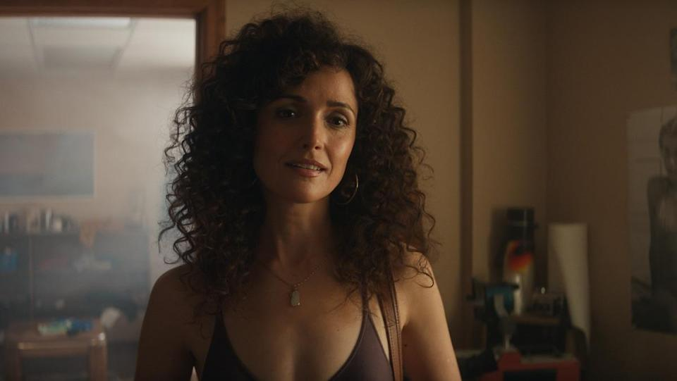 Rose Byrne with big curly hair wearing a leotard on Apple TV's Physical