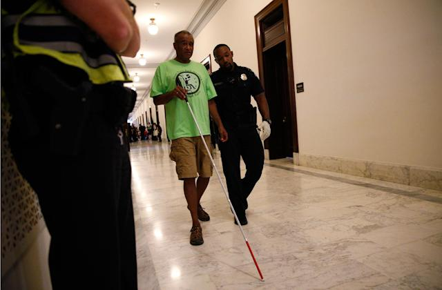 <p>A protester is escorted by police away from a demonstration outside Senate Majority Leader Mitch McConnell's constituent office after Senate Republicans unveiled their healthcare bill in Washington, June 22, 2017. (Photo: Kevin Lamarque/Reuters) </p>