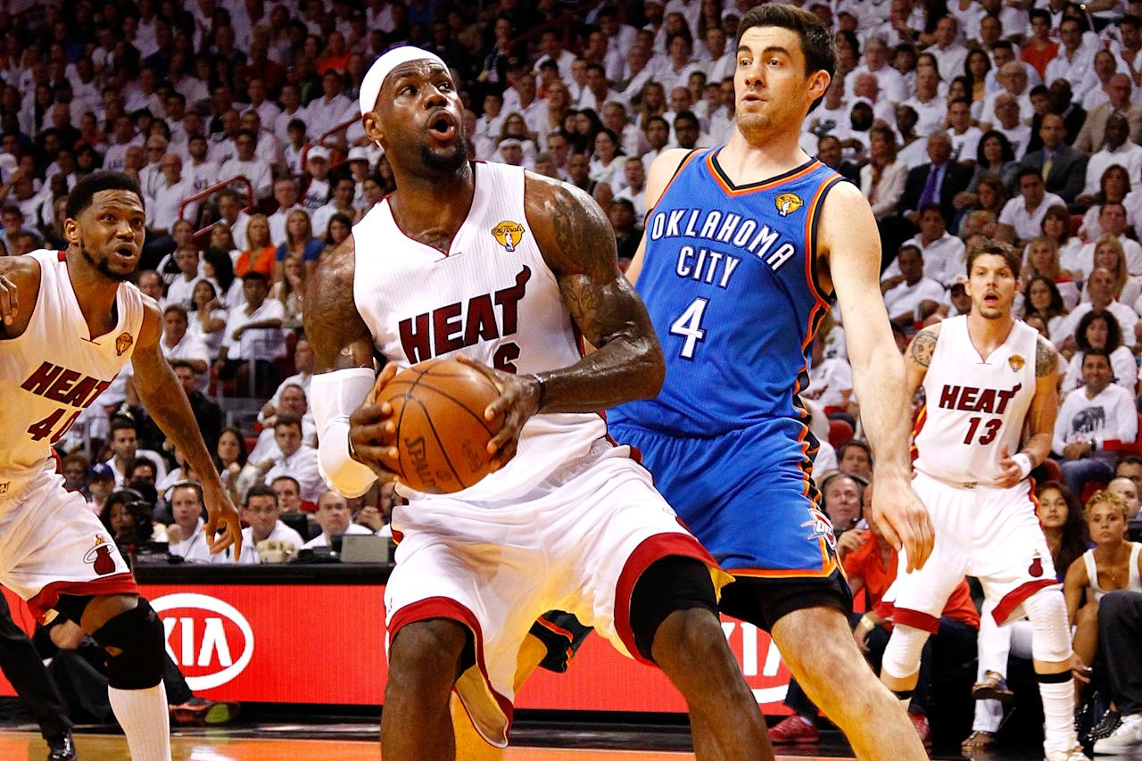 MIAMI, FL - JUNE 17:  LeBron James #6 of the Miami Heat drives in the first half against Nick Collison #4 of the Oklahoma City Thunder in Game Three of the 2012 NBA Finals on June 17, 2012 at American Airlines Arena in Miami, Florida.  NOTE TO USER: User expressly acknowledges and agrees that, by downloading and or using this photograph, User is consenting to the terms and conditions of the Getty Images License Agreement.  (Photo by Mike Ehrmann/Getty Images)