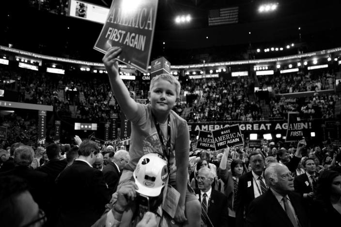 <p>Dillon Lucas, 9, of Princeton, W.Va., rides on the shoulders of a West Virginia delegate. (Photo: Khue Bui for Yahoo News)</p>