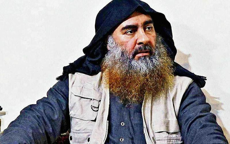 Abu Bakr Al-Baghdadi, the late Isil chief, killed himself and two children by detonating a suicide vest during a US raid in Syria - REX