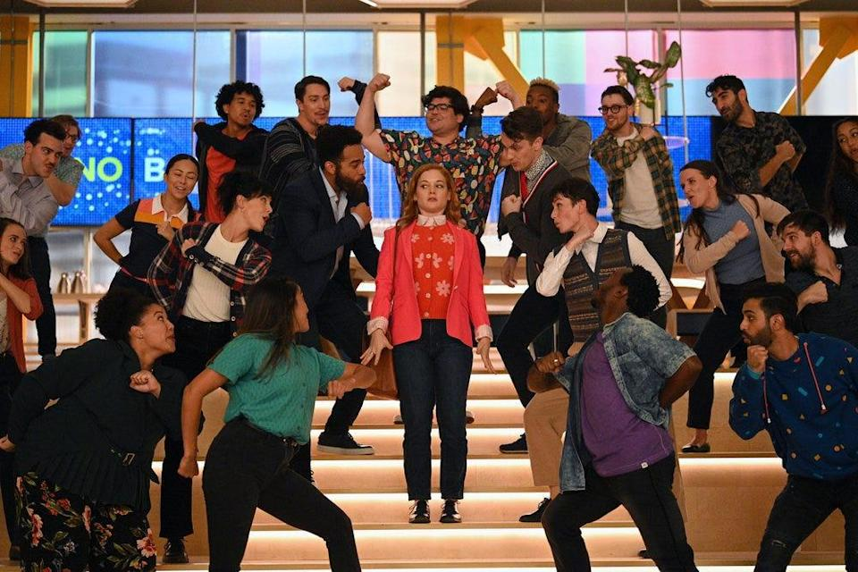 """Zoey (Jane Levy) returns to work for the first time since her father's (Peter Gallagher) death, greeted by her coworkers in an elaborately choreographed rendition of """"Hello, Dolly!"""""""