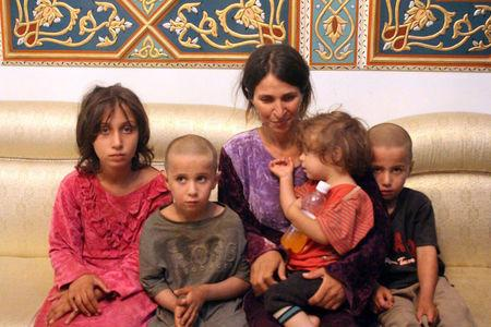 Woman and her children are seen after being freed from IS in Sweida