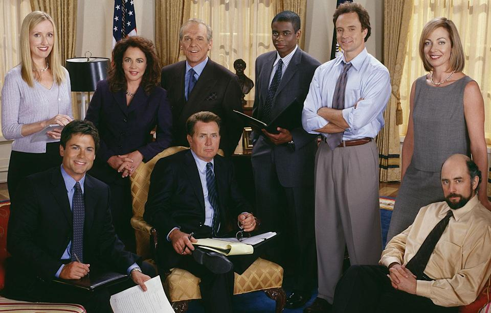 'The West Wing' (Front Row) Rob Lowe, Martin Sheen, Richard Schiff. (Back Row) Janel Moloney, Stockard Channing, John Spencer, Dule Hill, Bradley Whitford and Allison Janney. (© Warner Bros. Entertainment, Inc.)