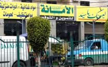 View shows a market for groceries with a Hezbollah slogan on it, in Beirut suburbs