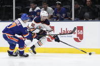 New York Islanders center Jordan Eberle (7) defends against Edmonton Oilers right wing Tomas Jurco (92) during the first period of an NHL hockey game Tuesday, Oct. 8, 2019, in Uniondale, N.Y. (AP Photo/Kathy Willens)