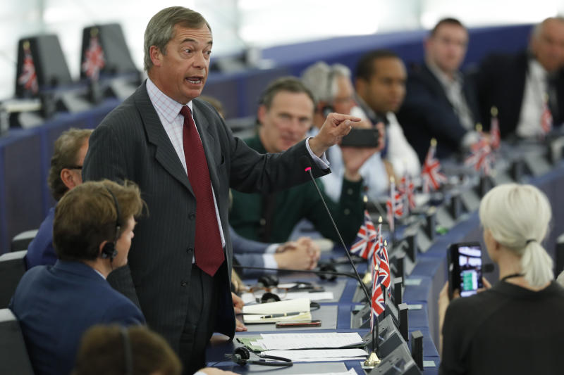 Brexit Party chairman Nigel Farage, center, speaks during a debate at the European Parliament in Strasbourg, eastern France, Tuesday July 16, 2019. Outgoing German defense minister Ursula von der Leyen is seeking to woo enough legislators at the European Parliament to secure the job of European Commission President in a secret vote late Tuesday. (AP Photo/Jean-Francois Badias)