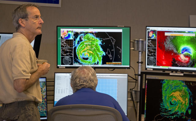 National Hurricane Center Acting Director Ed Rappaport, left, and Senior Hurricane Specialist Richard Pasch monitor Hurricane Irma Sunday, Sept. 10, 2017, at the National Hurricane Center in Miami. Forecasters declared the official landfall of Irma at 9:10 a.m. over Cudjoe Key, Fla. (Andy Newman/AP)