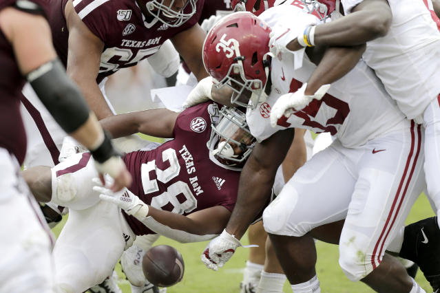 Texas A&M running back Isaiah Spiller (28) has the ball stripped away from him by Alabama linebacker Shane Lee (35) for a turnover during the first half of an NCAA college football game, Saturday, Oct. 12, 2019, in College Station, Texas. (AP Photo/Sam Craft)
