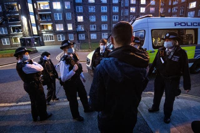 Police officers and special constables talk to a suspect following a stop and search in Walworth, Southwark (Victoria Jones/PA)