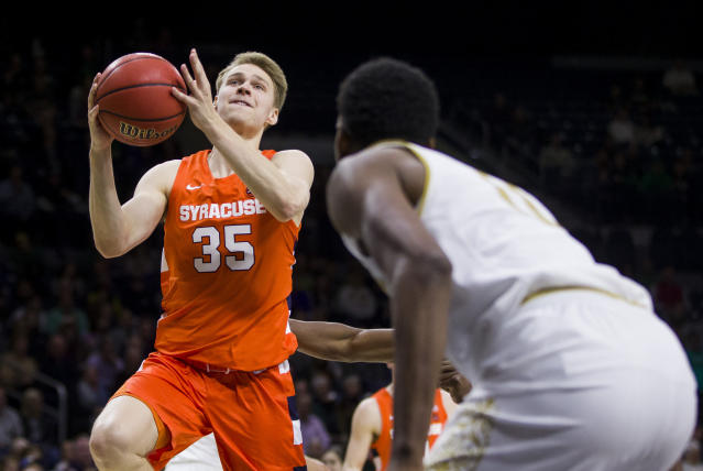 Syracuse's Buddy Boeheim(35) goes up for a shot in front of Notre Dame's Juwan Durham during the second half of an NCAA college basketball game Wednesday, Jan. 22, 2020, in South Bend, Ind. Syracuse won 84-82. (AP Photo/Robert Franklin)