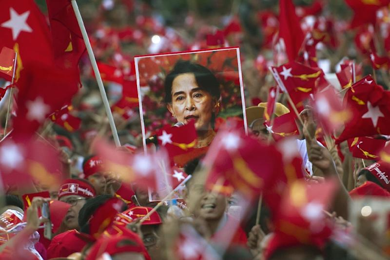 Power beckons for Aung San Suu Kyi's pro-democracy movement as it continues to grab parliamentary seats previously held by the ruling party in army-dominated Myanmar (AFP Photo/Ye Aung Thu)