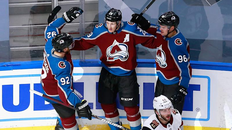 EDMONTON, ALBERTA - AUGUST 14: Nathan MacKinnon #29 of the Colorado Avalanche (C) celebrates his goal at 3:40 of the first period against the Arizona Coyotes and is joined by Gabriel Landeskog #92 (L) and Mikko Rantanen #96 (R) in Game Two of the Western Conference First Round during the 2020 NHL Stanley Cup Playoffs at Rogers Place on August 14, 2020 in Edmonton, Alberta, Canada. (Photo by Jeff Vinnick/Getty Images)