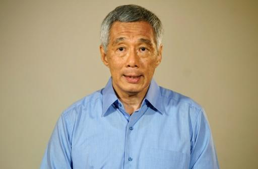 Singapore PM says sorry for family feud