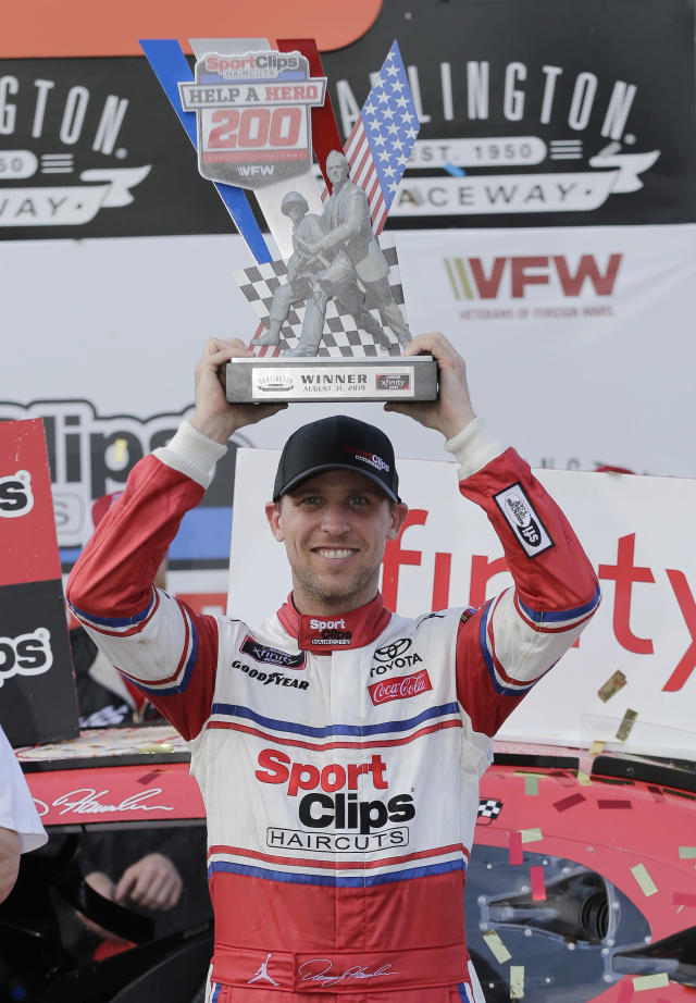 ADD HAMLIN STRIPPED OF WIN - Denny Hamlin holds up his trophy in Victory Lane after winning a NASCAR Xfinity Series auto race on Saturday, Aug. 31, 2019, at Darlington Raceway in Darlington, S.C. Hamlin was stripped of his win after he failed post-race inspection. Cole Custer was declared the winner. (AP Photo/Terry Renna)