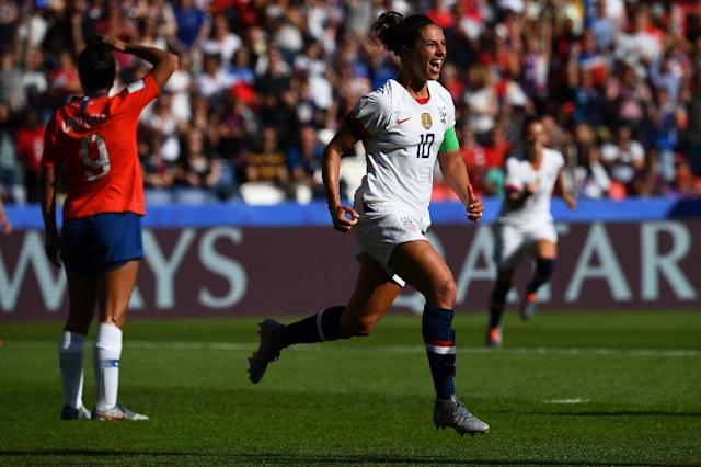 Carli Lloyd scored twice and missed a penalty as the USA eased to a 3-0 win over Chile to qualify for the last 16 of the World Cup (AFP Photo/FRANCK FIFE)