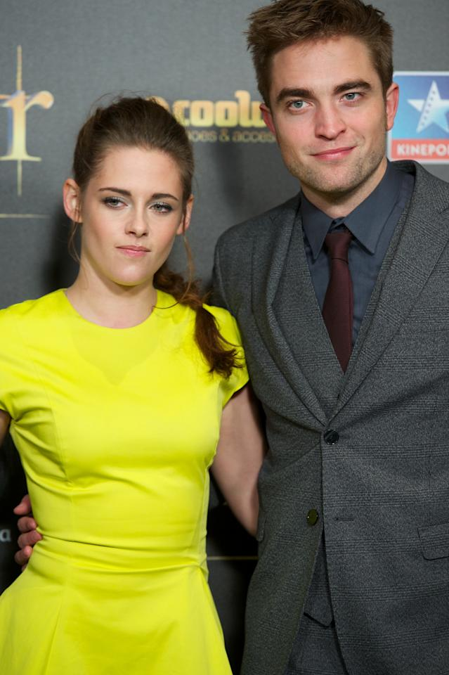"""MADRID, SPAIN - NOVEMBER 15:  Actress Kristen Stewart and actor Robert Pattinson attend the """"The Twilight Saga: Breaking Dawn - Part 2"""" (La Saga Crepusculo: Amanecer Parte 2) premiere at the Kinepolis cinema on November 15, 2012 in Madrid, Spain.  (Photo by Carlos Alvarez/Getty Images)"""