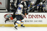 St. Louis Blues center Ivan Barbashev checks Anaheim Ducks left wing Max Jones during the third period of an NHL hockey game in Anaheim, Calif., Wednesday, March 11, 2020. (AP Photo/Chris Carlson)