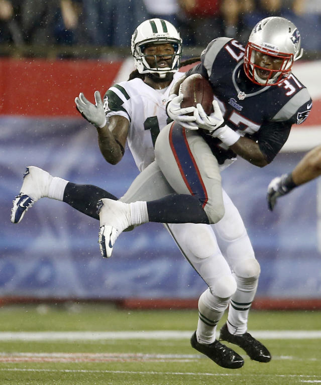 New England Patriots cornerback Alfonzo Dennard (37) intercepts a pass intended for New York Jets wide receiver Clyde Gates, rear, during the fourth quarter of an NFL football game Thursday, Sept. 12, 2013, in Foxborough, Mass. (AP Photo/Elise Amendola)