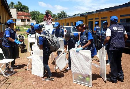 World Health Organization workers prepare a centre for vaccination during the launch of a campaign aimed at beating an outbreak of Ebola in the port city of Mbandaka