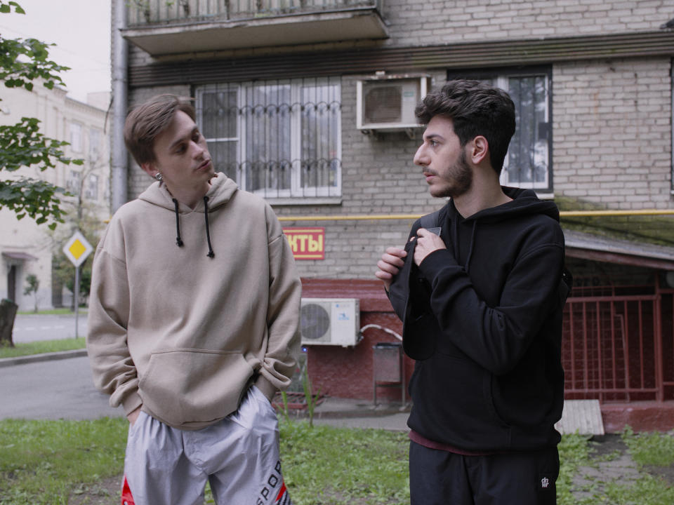 """This image released by Fancy Production shows actors Dmitry Simonov as Lyosha and Arsen Khandzhyan as Roma in a scene from the """"Here I come"""" web series in Moscow, Russia, Saturday, July 18, 2020. Russian screenwriter Elizaveta Simbirskaya, 31, and director Andrei Fenocka, 27, have just released Here I Come, a web series about queer teenagers in Russia. (Fancy Production via AP)"""