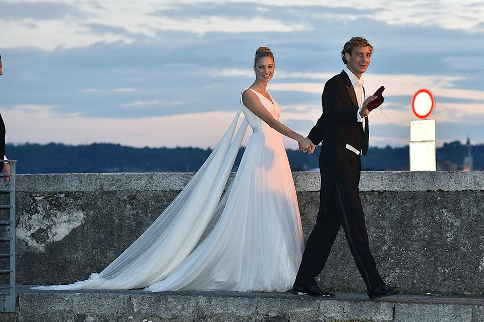 Pictured at her wedding on August 1, 2015 in Angera, Italy in one of her four couture wedding dresses. (Getty Images)