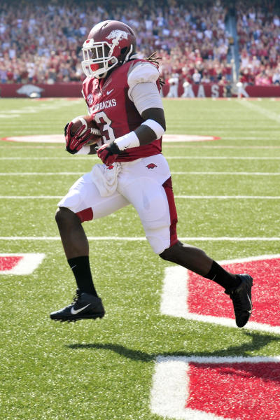 Arkansas running back Alex Collins carries into the end zone for a touchdown during the first half of an NCAA college football game against South Carolina in Fayetteville, Ark., Saturday, Oct. 12, 2013. (AP Photo/April L. Brown)