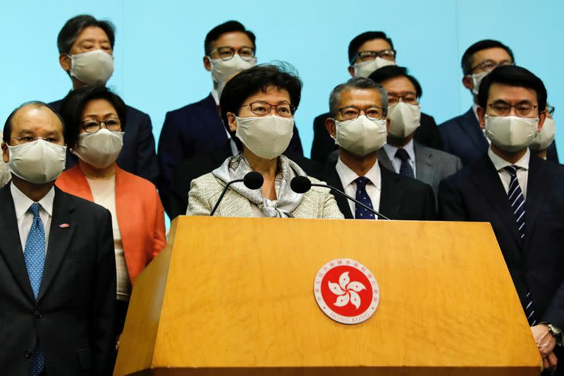 Hong Kong Chief Executive Carrie Lam, wearing a face mask following the coronavirus disease (COVID-19) outbreak, attends a news conference with officers over Beijing's plans to impose national security legislation in Hong Kong