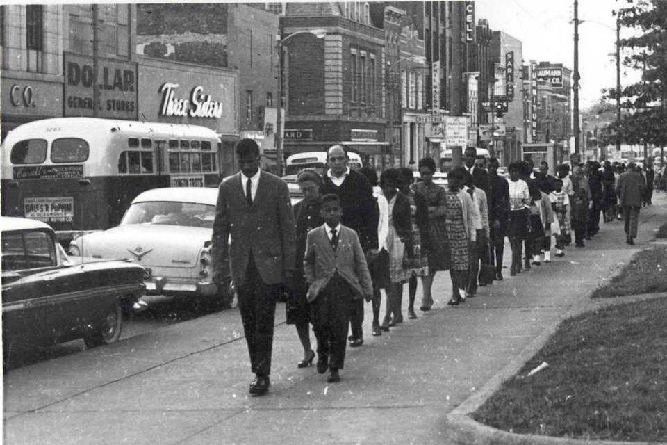 Henry W. Jones walked at the front of civil rights demonstrators marching down Main St in Lexington, KY in this undated photo. Photos of the civil rights movement in Lexington, KY in the 1960s. Photo Courtesy Calvert McCann