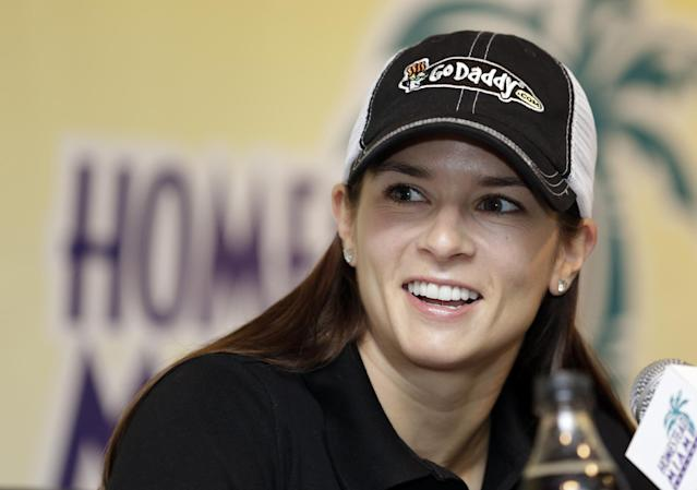 Driver Danica Patrick smiles at a question by a reporter during a news conference for Sunday's NASCAR Sprint Cup series auto race at the Homestead-Miami Speedway, Saturday, Nov. 16, 2013, in Homestead, Fla. (AP Photo/Alan Diaz)