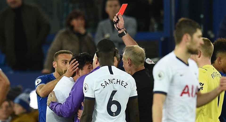 Son Heung-min is shown a red card for his tackle on Andre Gomes. (Credit: Getty Images)