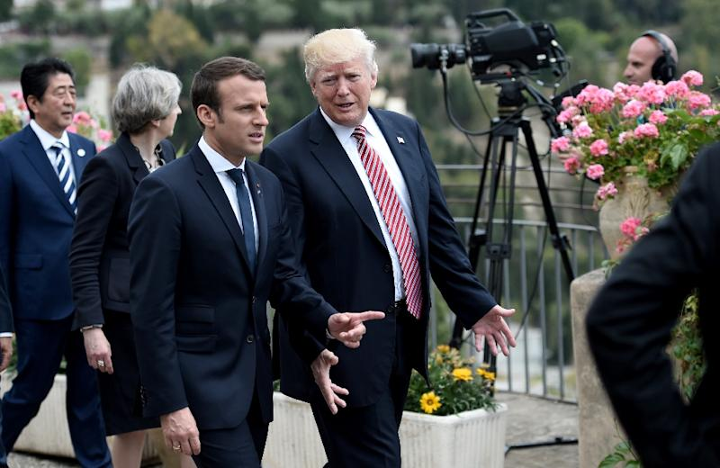US President Donald Trump (R) talks with French President Emmanuel Macron as they attend the G7 Summit May 26, 2017 in Italy